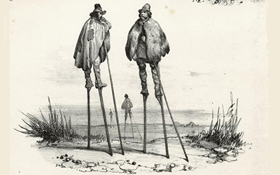 men with capes on stilts